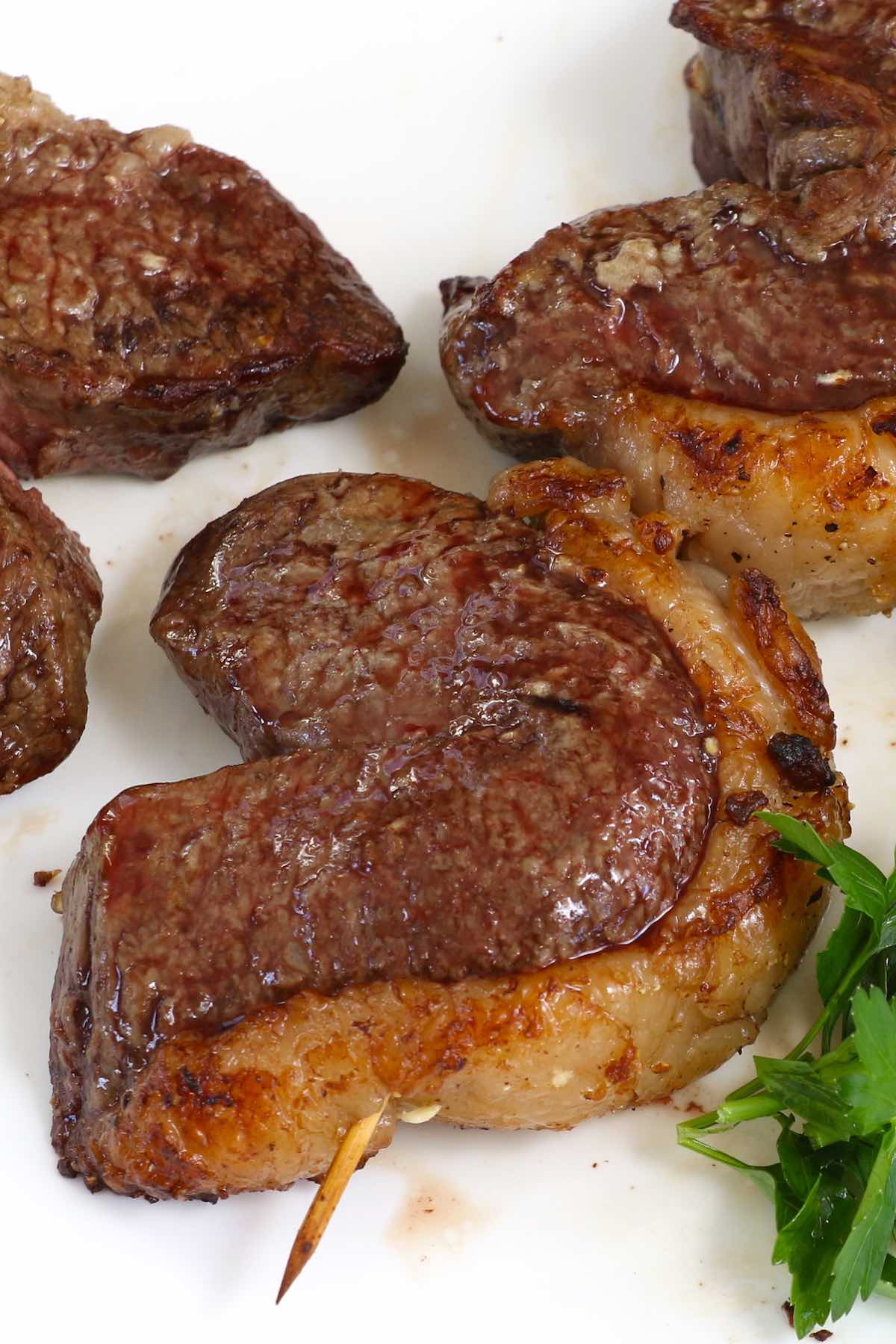 Picanha steak cooked Brazilian style on skewers in horseshoe shapes