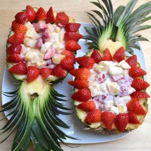 Strawberry Cheesecake Salad in Pineapple Boats is a fun dessert that's easy to make