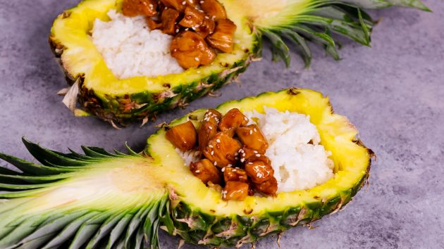 Pineapple Teriyaki Chicken served with rice in a fresh pineapple