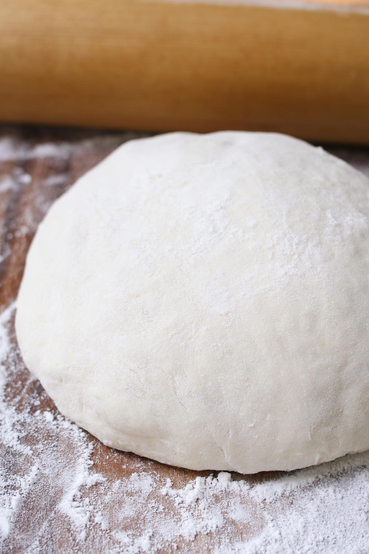This Easy Pizza Dough Recipe makes a soft and fluffy pizza crust that's beyond addictive! It's the best homemade pizza dough that has been passed down through generations. It takes 10 minutes to prepare and made by hand with 6 simple ingredients!