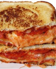 This Double Decker Pizza Sandwich recipe may be the best grilled cheese ever