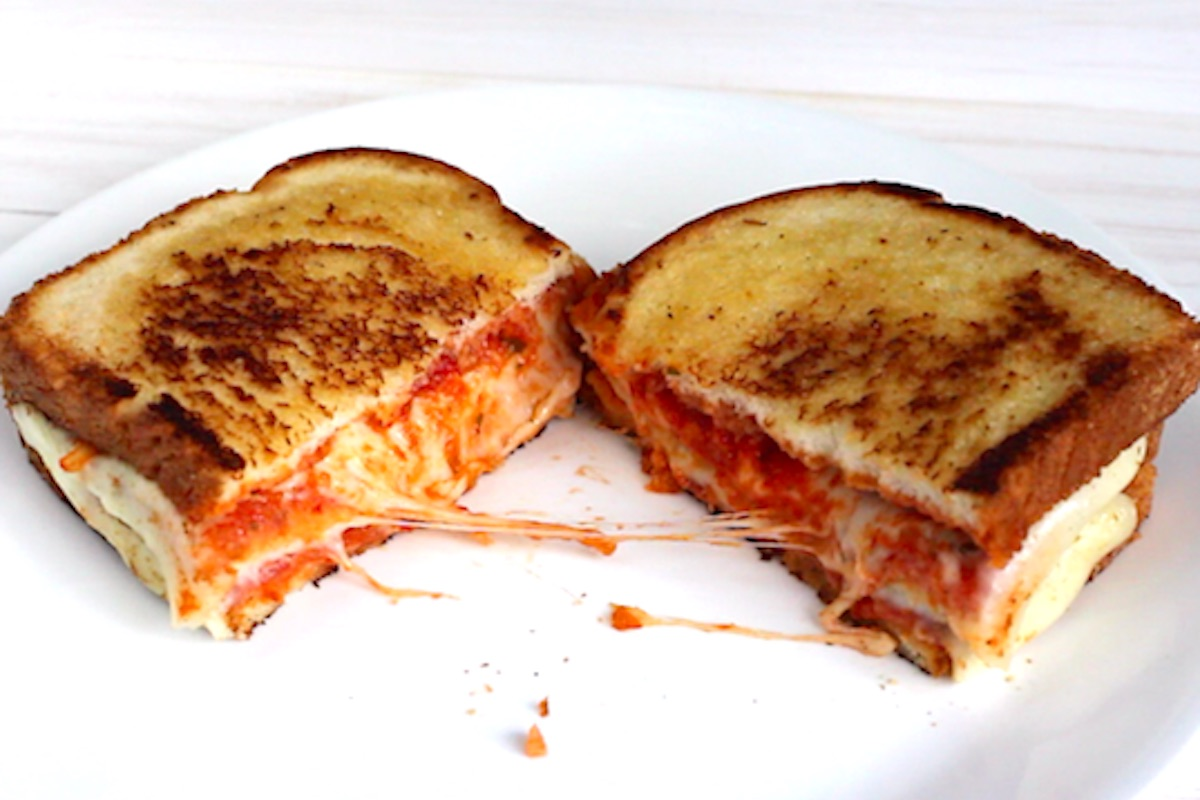 Serving a pizza sandwich on a white plate.