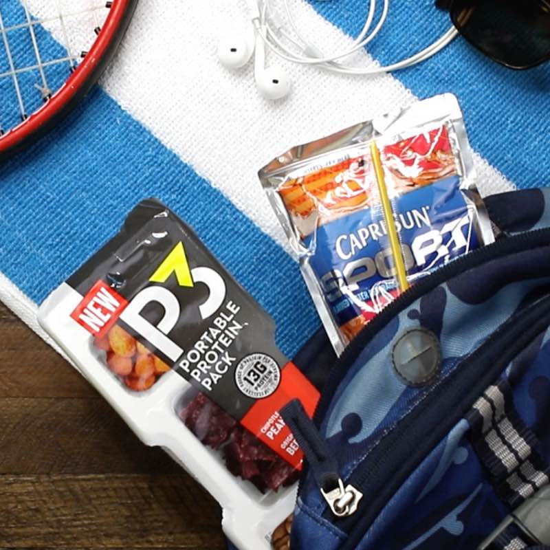 This photo shows Planters P3 and Capri Sun Sport drinks in a backpack for a back-to-school snack combo