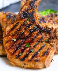 The Best Ever Pork Chop Marinade produces tender and flavorful pork chops every time! It's an easy pork marinade recipe made with soy sauce, brown sugar, vinegar, garlic, olive oil, and ketchup. You can use the marinated pork chops for grilling, pan frying, or baking.