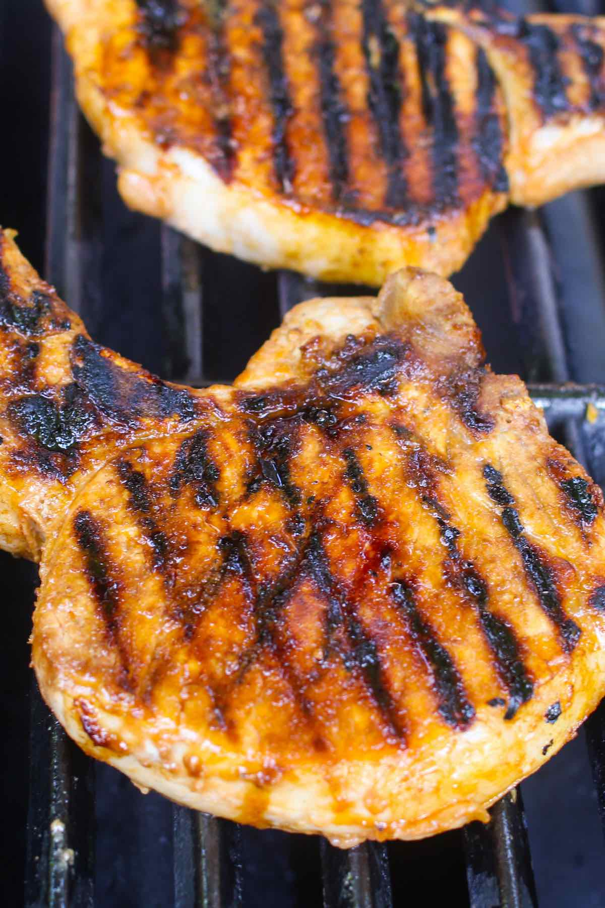 Marinated pork chops on the grill.