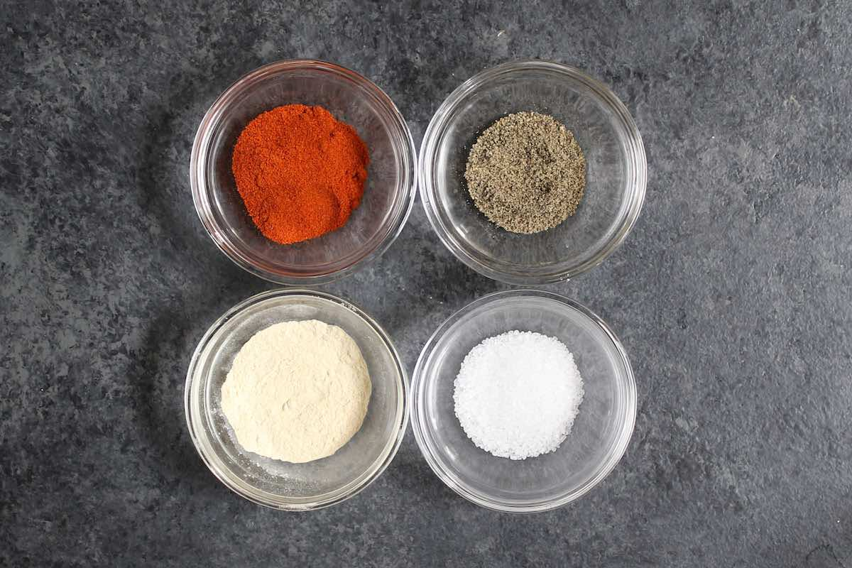 Seasonings for fried pork chops: paprika, garlic powder, salt and pepper