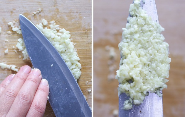 How to Puree Garlic with a knife on a cutting board with salt when making garlic butter