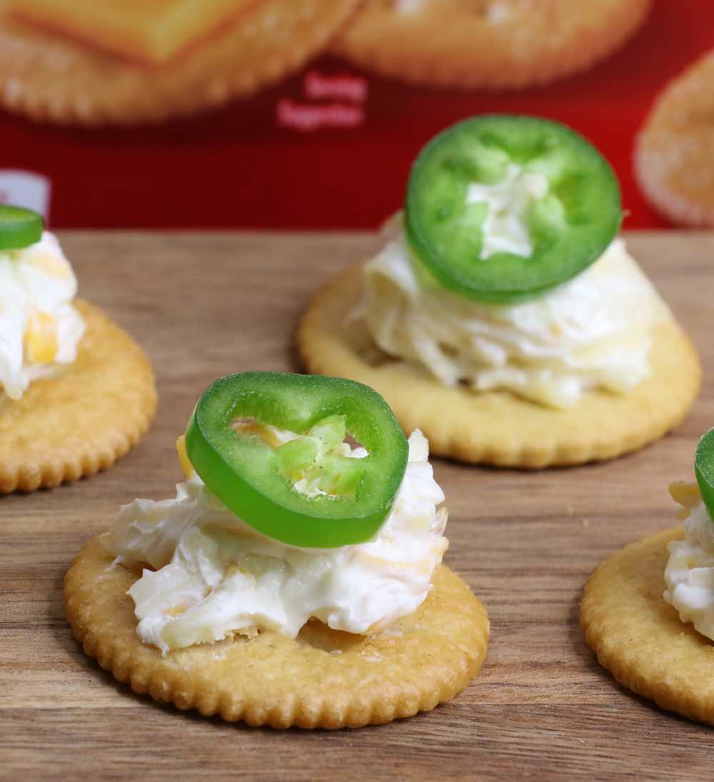 Simple and easy Ritz Cracker Appetizers: pair sweet and savory bite-sized finger food for your next party. These 4 recipes are so easy and come together in no time. 1. Jalapeno Popper Topper; 2. Raspberry Chocolate Cheesecake Bites; 3. Shrimp and Avocado Bites; 4. Strawberry Cheesecake Bites. Use versatile and delicious RITZ Crackers for all your entertaining needs. #SpreadRITZpiration #ad