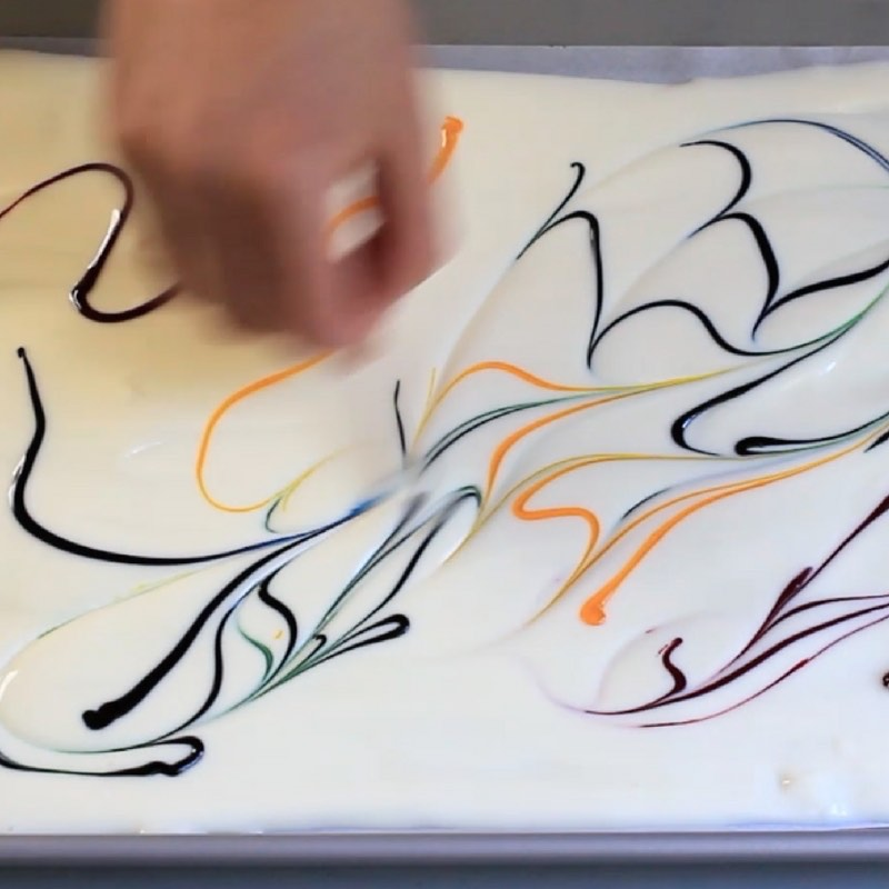 Marbling chocolate using a toothpick