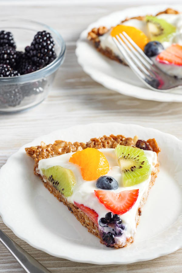 A serving of Raisin Bran Fruit Pizza on a plate as part of a delicious breakfast on the lighter side