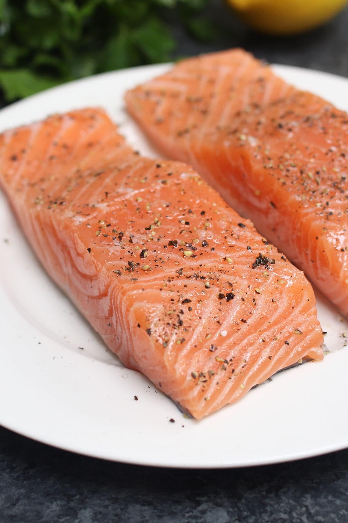 Dry seasoned salmon fillets ready for baking