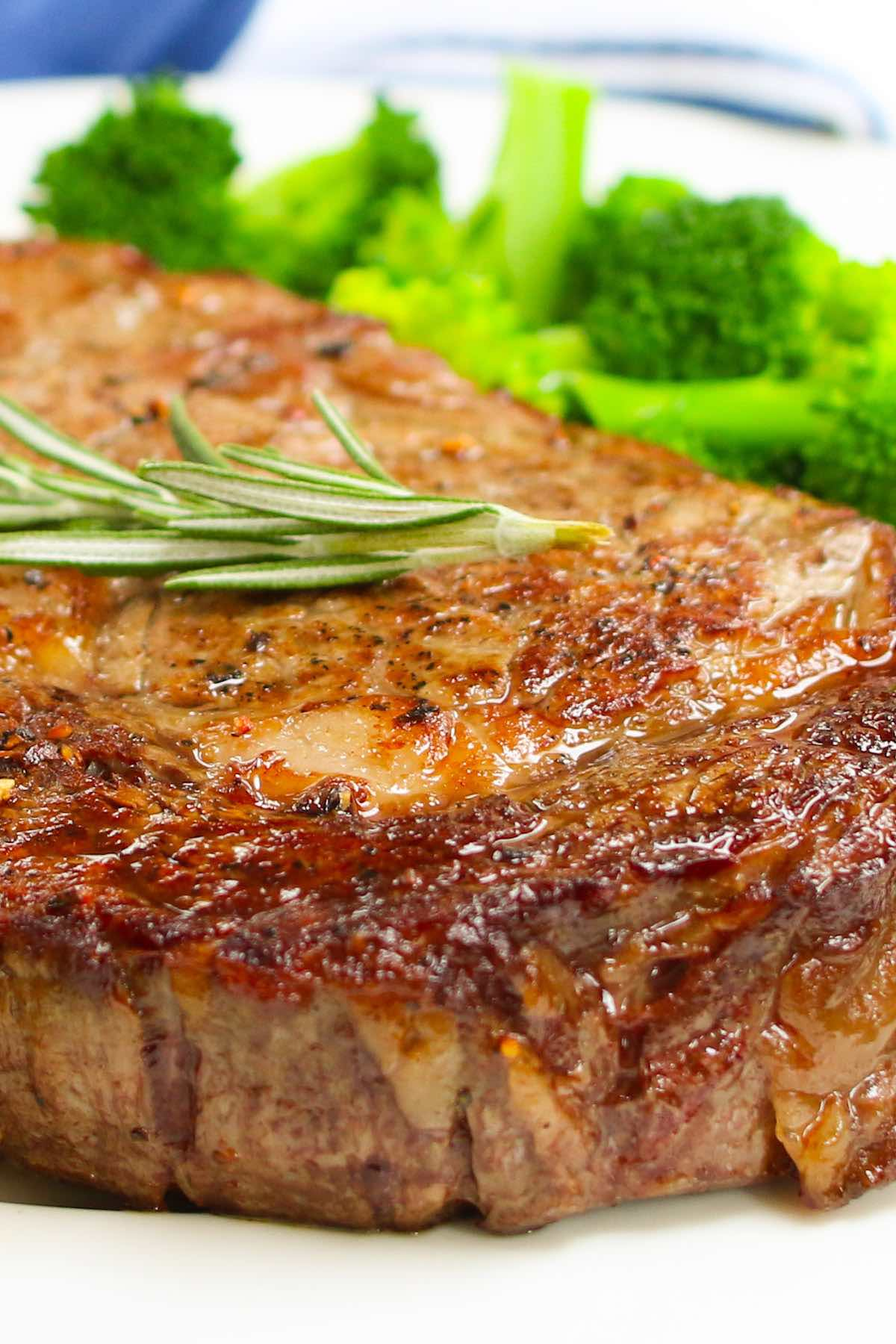 Closeup of the surface of a rib eye showing beautiful caramelization and seasoning after cooking. This rib eye steak recipe is pan seared to perfection in a cast iron pan with olive oil, butter, salt and pepper