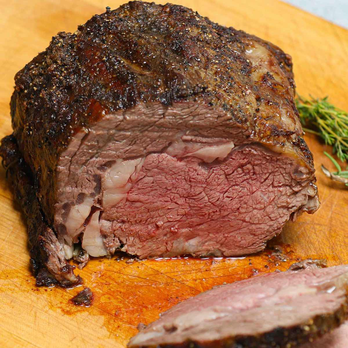 A serving of boneless prime rib with mashed potatoes, broccoli and horseradish