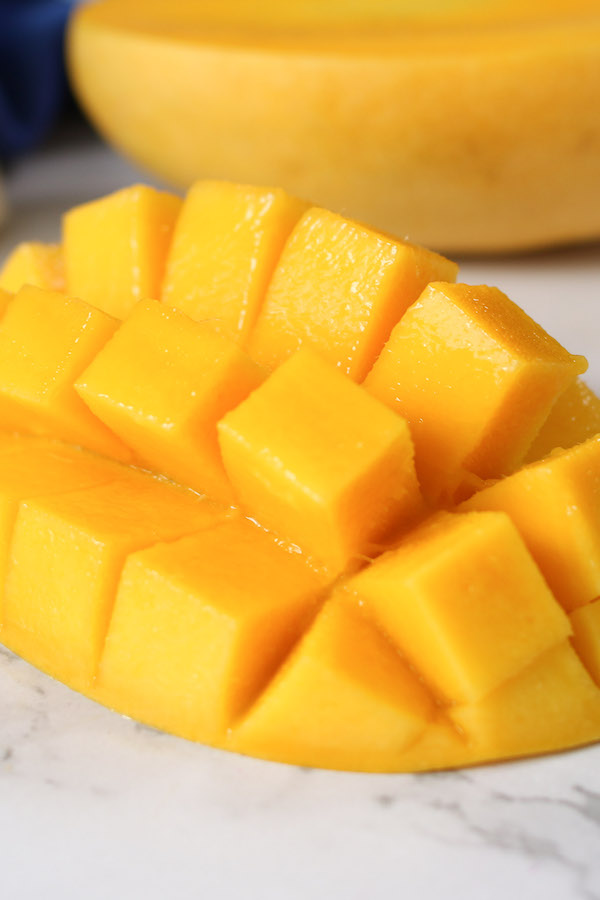 This ripe mango has juicy, golden colored flesh that's easy to cut into cubes