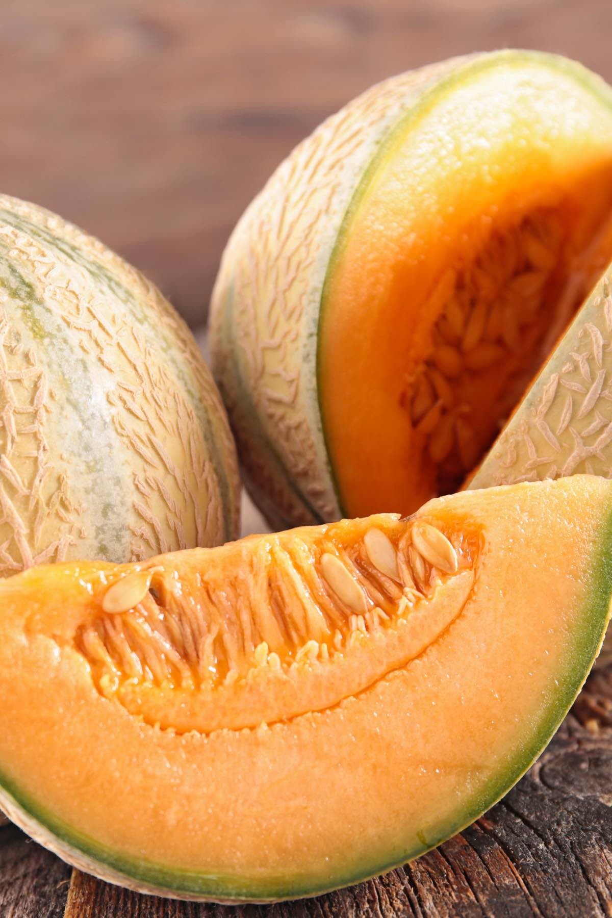 Wedges of ripe cantaloupe with bright, coral-colored flesh