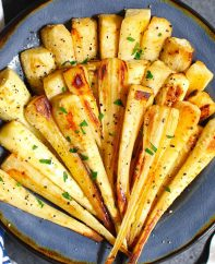 Roasted Parsnips are a very simple but delicious vegetable side dish that's sweet and tender. This recipe makes perfect parsnips with a caramelized surface that enhances the natural flavor.