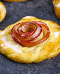 This Rose Apple Danish has a beautiful apple rose in the middle surrounded by flaky pasty and topped with homemade icing