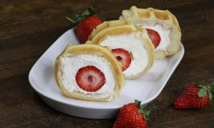 Strawberry Waffle Roll Cake - a quick and easy breakfast, snack or dessert made with waffles, fresh strawberries, and whipped cream. Soft waffle topped with whipped cream, and strawberries. It melts in your mouth! So good and so beautiful! No bake dessert, vegetarian! | tipbuzz.com