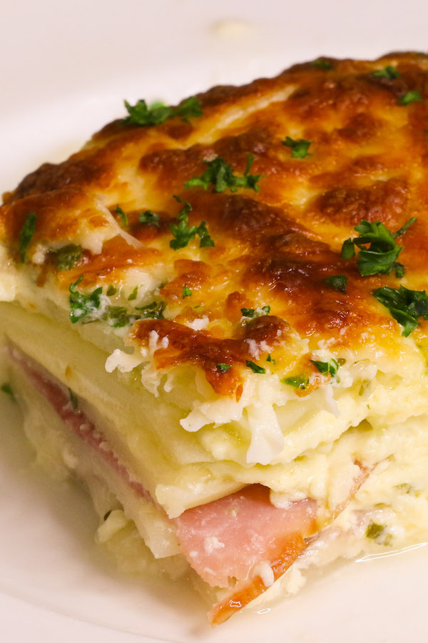 Scalloped Potatoes and Ham served on a white plate