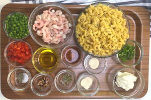 Ingredients for pasta salad made with shrimp