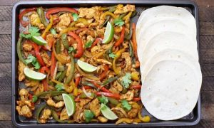 Sheet Pan Chicken Fajitas – one of the easiest healthy dinner recipes. Yellow, red and green peppers, sliced onions and chicken breasts, mixed with some simple spices (ground cumin, chili powder, garlic powder, salt and olive oil). Perfectly baked in the oven, and served on flour tortillas. Simply Yummy! Make-ahead recipe. Quick and easy dinner recipe. | tipbuzz.com