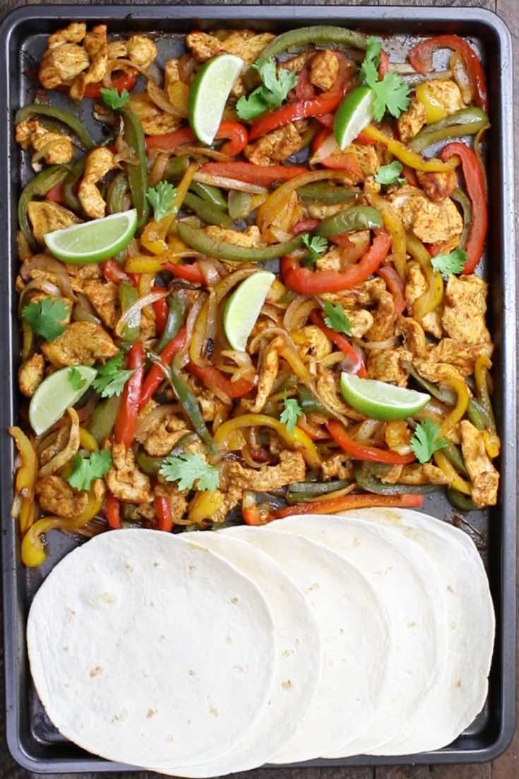 Sheet Pan Chicken Fajita – one of the easiest healthy dinner recipes. Yellow, red and green peppers, sliced onions and chicken breasts, mixed with some simple spices (ground cumin, chili powder, garlic powder, salt and olive oil). Perfectly baked in the oven, and served on flour tortillas. Simply Yummy! Make-ahead recipe. Quick and easy dinner recipe. | tipbuzz.com