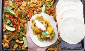 Sheet Pan Chicken Fajitas – one of the easiest healthy dinner recipes. Yellow, red and green peppers, sliced onions and chicken breasts, mixed with some simple spices (ground cumin, chili powder, garlic powder, salt and olive oil). Perfectly baked in the oven, and served on flour tortillas. Simply Yummy! Make-ahead recipe. Quick and easy dinner recipe.