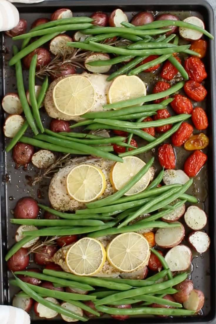 This photo shows the cooked ingredients for sheet pan chicken before green vegetables are added