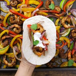 These Baked Shrimp Fajitas is an easy one pan meal with gorgeously browned and sizzling shrimp mixed with delicious vegetables cooked with fajita seasonings. It tastes amazing and takes only 20 minutes to make.