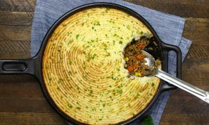 The Best Skillet Shepherd's Pie – Loaded with delicious and flavorful filing of beef, onions, carrots, green beans and corn, then topped with a buttery and creamy mashed potatoes with parmesan cheese. Baked to perfection golden color. An incredible comfort food! #DinnerRecipe. #shepherds pie Video recipe.