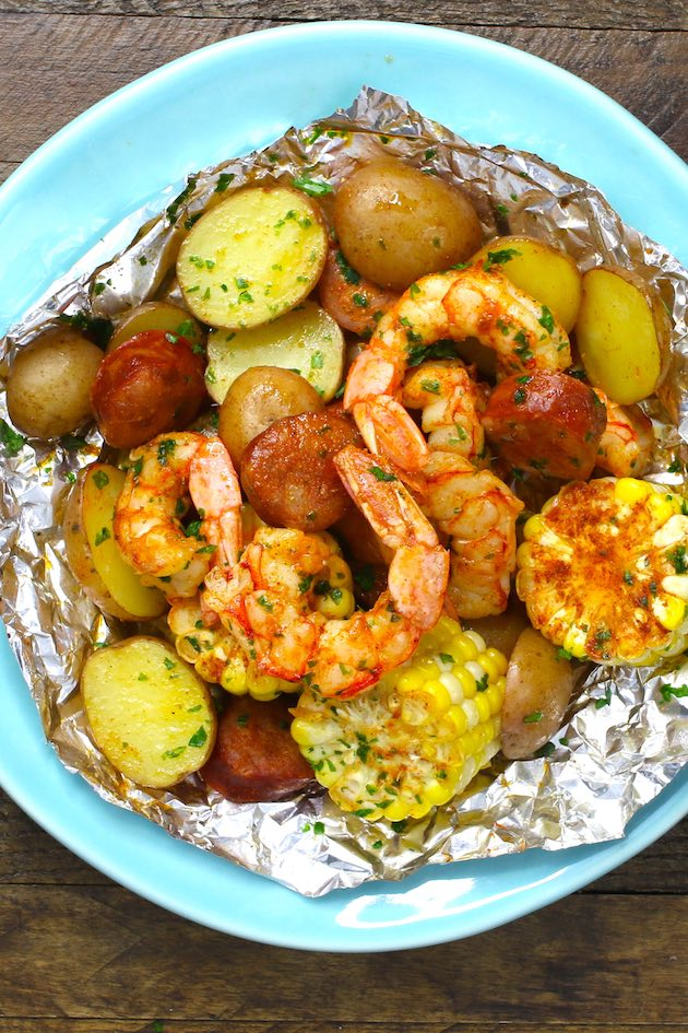 Overhead view of a Shrimp Boil Foil Packet opened up and served in a plate for a delicious summertime meal