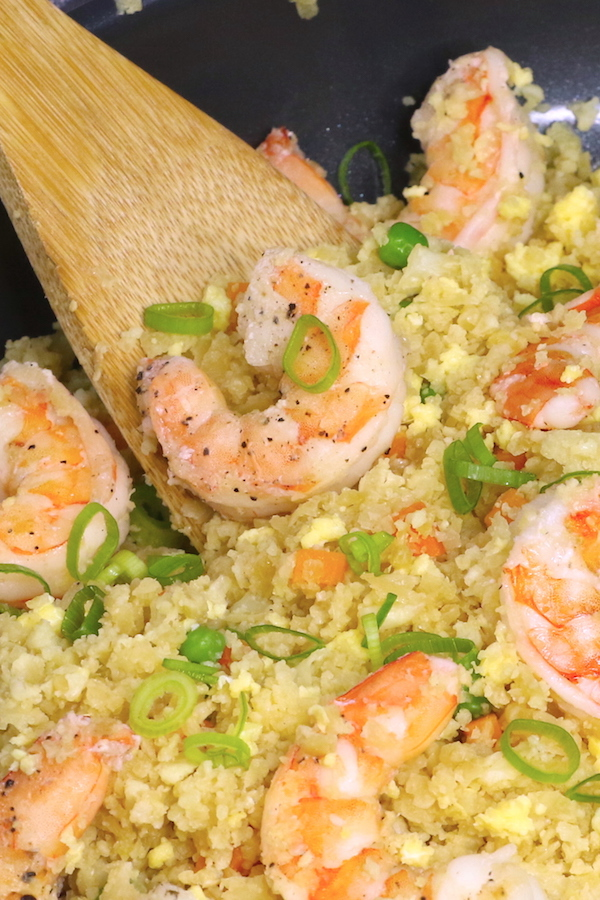 Shrimp cauliflower fried rice in a skillet before serving