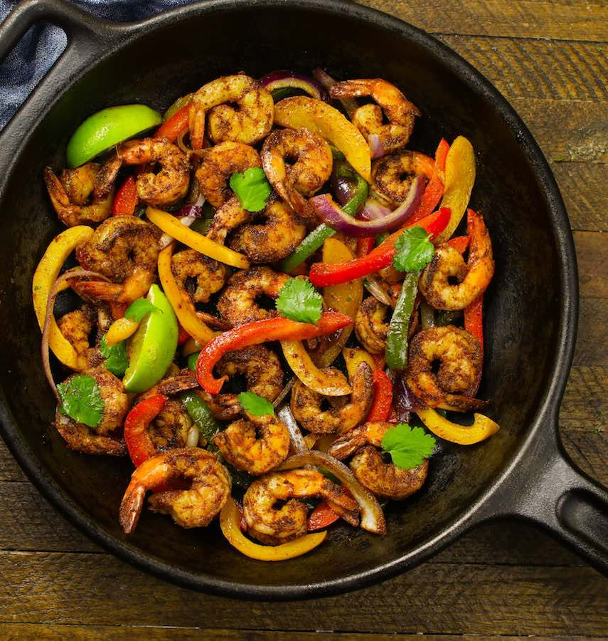 Shrimp Fajitas in a cast iron skillet