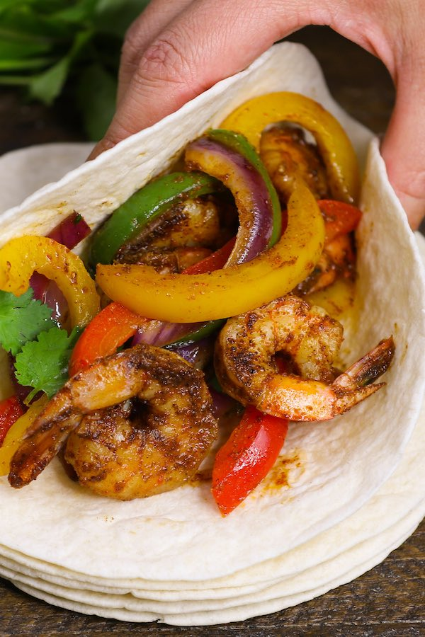 These Shrimp Fajitas are easy to make in just 15 minutes – sizzling, caramelized shrimp cooked with seared bell peppers and onions in flavorful fajita seasonings. It's like restaurant-style fajitas but even better!