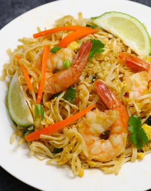 Shrimp Pad Thai is loaded with sweet, sour and spicy shrimp, mixed with rice noodles and vegetables. It's so simple and easy to make. Try it once and you won't want to go back to takeout! It comes together in only 20 minutes.