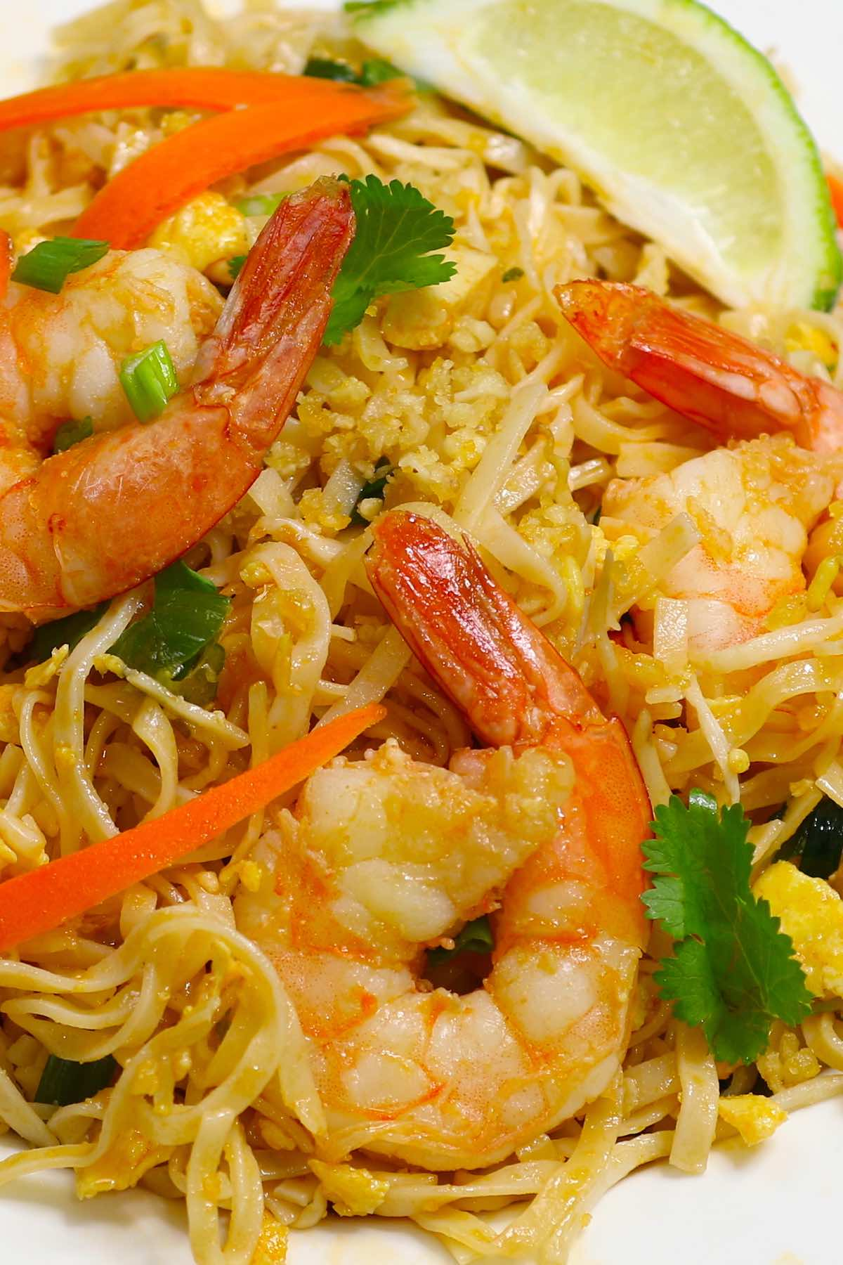 Shrimp Pad Thai is loaded with sweet, sour and spicy shrimp, rice noodles and vegetables. It's so simple and easy to make. Try it once and you won't want to go back to takeout! It comes together in only 20 minutes.