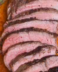 Slices of sirloin steak cooked to medium doneness
