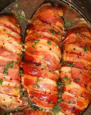 Slow Cooker Bacon Garlic Chicken Breast recipe makes the most tender, juicy and flavorful chicken meals of any other cooking methods with just 4 ingredients. The chicken breasts get a special treatment when wrapped with tasty bacon, which keeps the chicken moist.