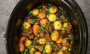 Slow Cooker Beef Stew is one of the best hearty and comfort food to make in a crock pot. Tender and melt-in-your-mouth beef is simmered in a rich and divine sauce with carrots, onions, and potatoes. Your family and friends will ask for this Crock Pot Beef Stew again and again! Plus recipe video tutorial!