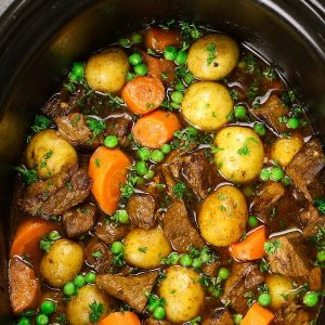 Slow Cooker Beef Stewis one of the best hearty and comfort food to make in a crock pot. Tender and melt-in-your-mouth beef is simmered in a rich and divine sauce with carrots, onions, and potatoes. Your family and friends will ask for this Crock Pot Beef Stew again and again! Plus recipe video tutorial!