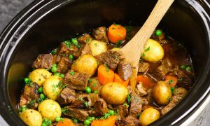The easiest, most unbelievably delicious Slow Cooker Beef Stew. It's one of my favorite comforting crock pot recipes. Juicy and tender beef cooked with onions, carrots, green peas and potatoes with garlic, red wine, Worcestershire sauce, Italian seasoning and beef broth. So delicious. Easy one pot recipe.