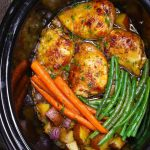 Crock Pot Chicken Thighs with potatoes, carrots and green beans in a honey garlic sauce, ready to serve