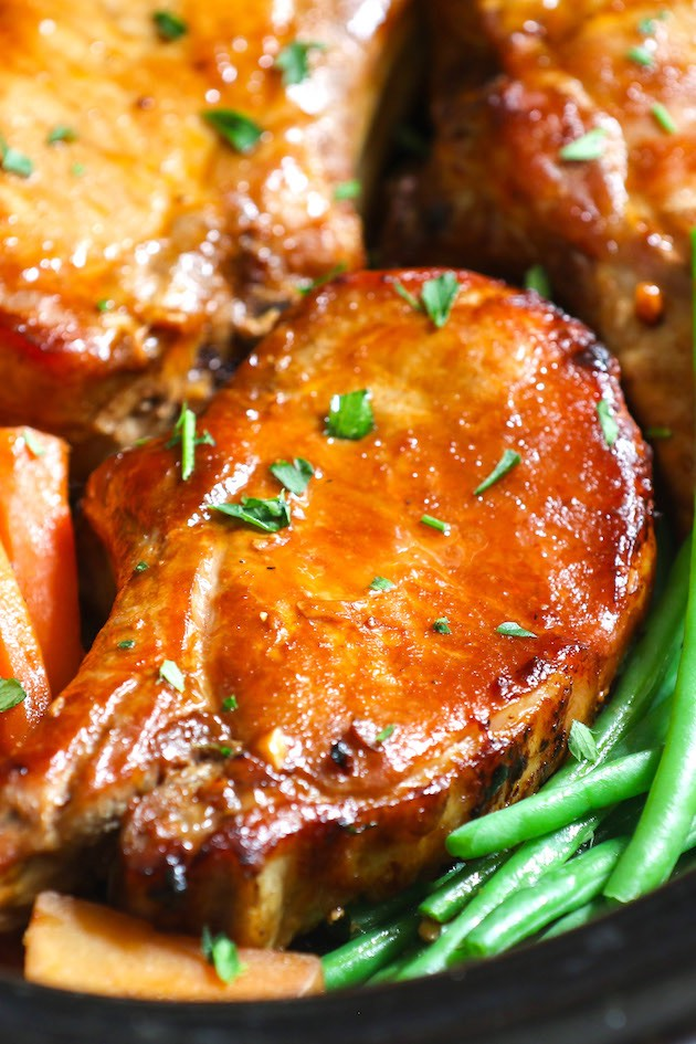 Closeup of Slow Cooker Pork Chops made with bone in rib chops and a delicious gravy