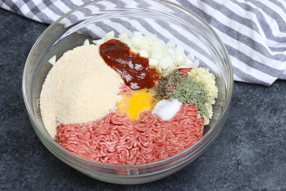 Ingredients for meatloaf in a mixing bowl