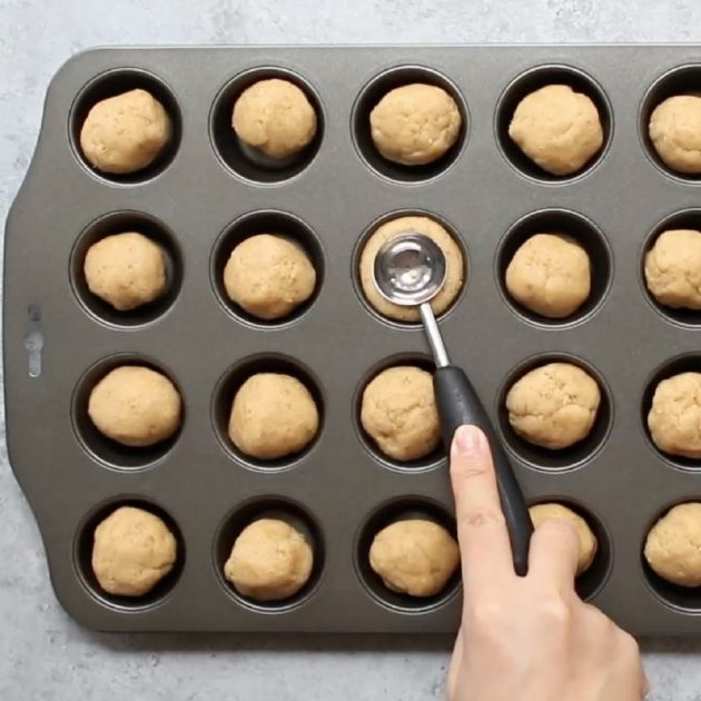 Using a melon baller to bake impressions in each cookie