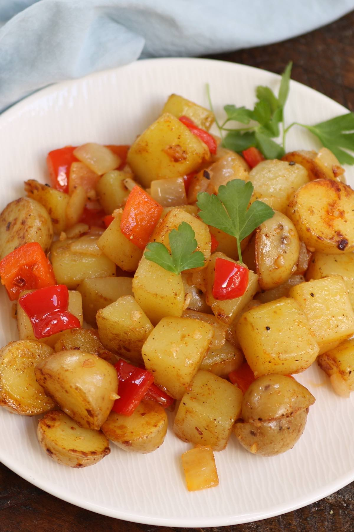 Southern smothered potatoes on a serving plate