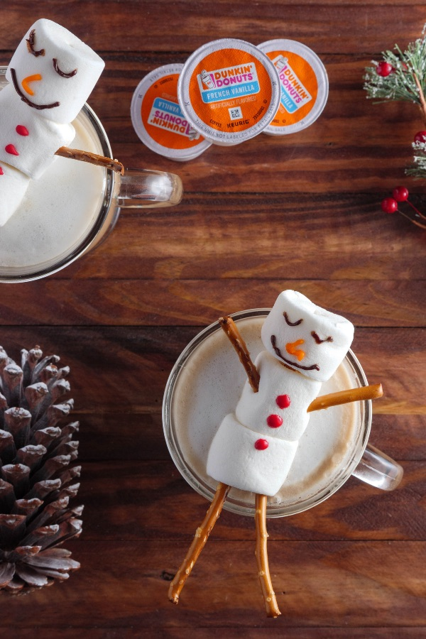 These Snowman Mocha Lattes are the perfect hot drink to serve guests during the holidays and they only take a few minutes to prepare using Dunkin' Donuts K-cups coffee pods