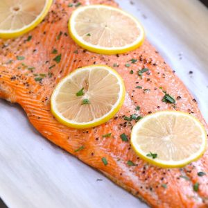 A fillet of sockeye salmon baked to perfection on a serving plate