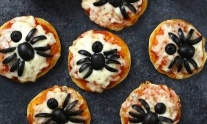 These Mini Spider Pizzas are the perfect snack for some spooky fun at your Halloween party