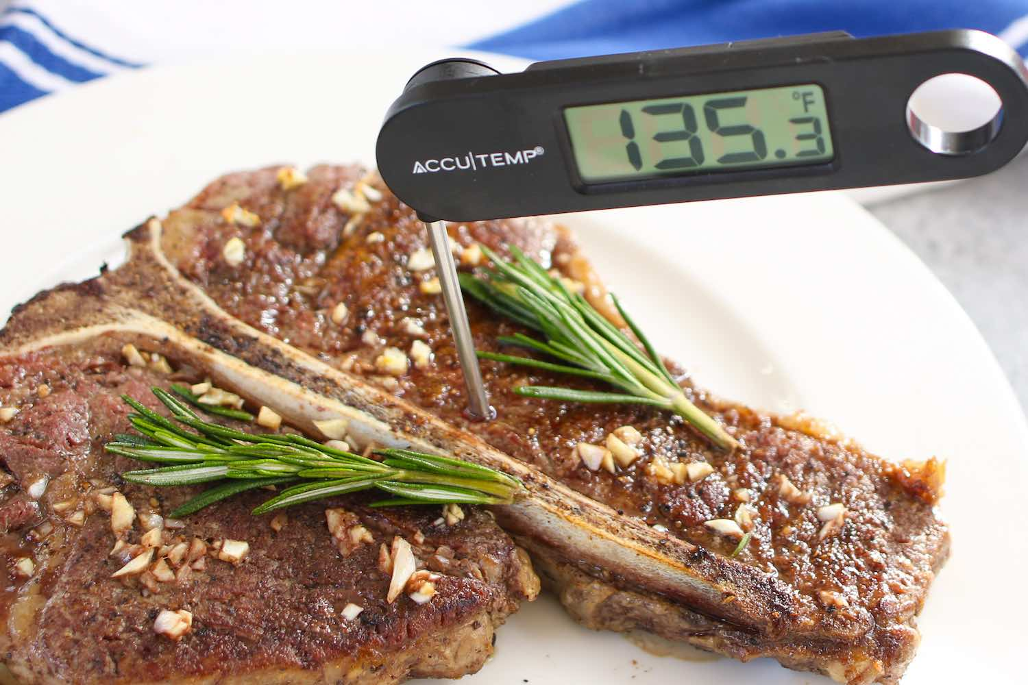 Check steak doneness is by inserting an instant-read thermometer into the middle of the steak